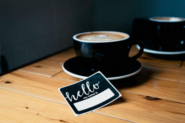 A name tag and a cup of coffee