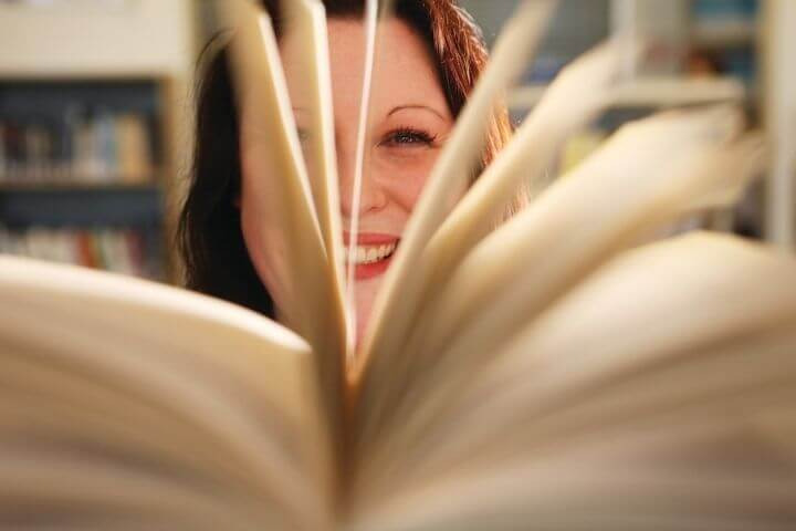 Student looking through a book