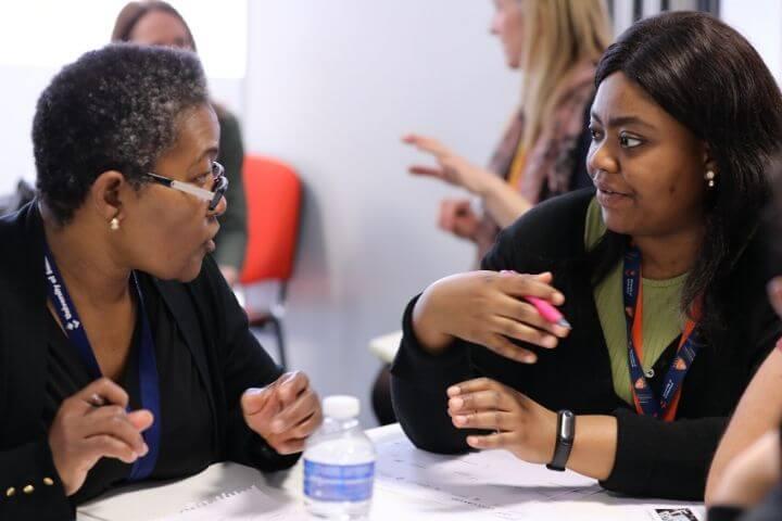 Two University of Sunderland in London student communicating at the Santander Enterprise event