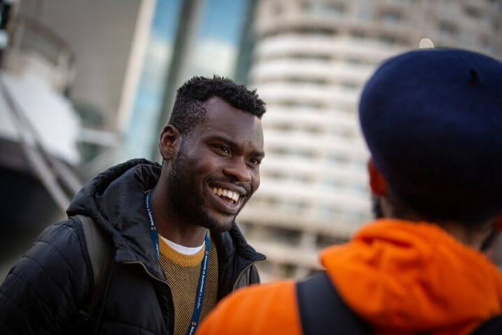 A University of Sunderland in London student talking with his friend