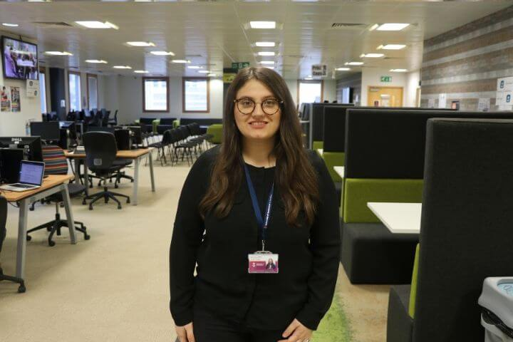 University of Sunderland in London student on her phone