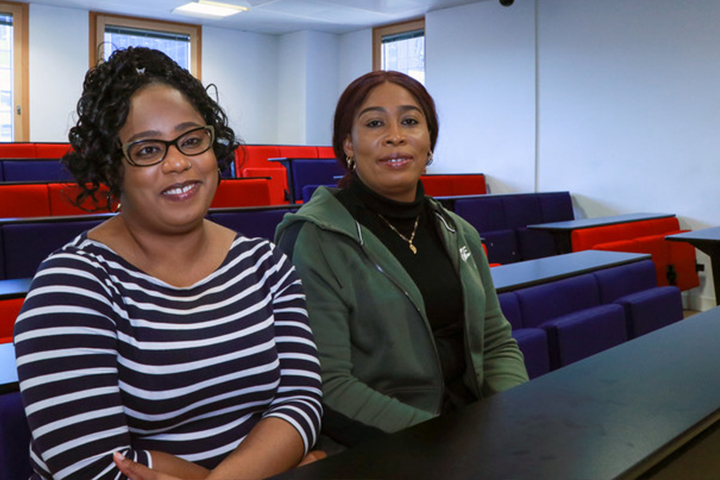 BSc (Hons) Health and Social Care Top-Up students Jessica Anthonette Grace and Anniesha Kimone Lecky in a lecture theatre at the University of Sunderland in London