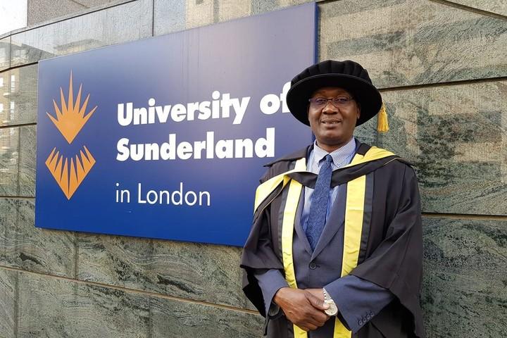 Sahidi Bilan in graduation robes