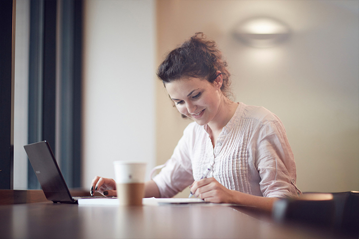 University of Sunderland student studying with laptop and coffee
