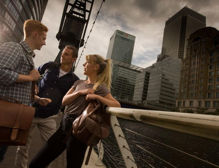 Three University of Sunderland in London students talking outside in Canary Wharf