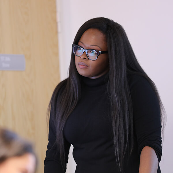 External lecturer Nai Kalema giving a talk at the University of Sunderland in London